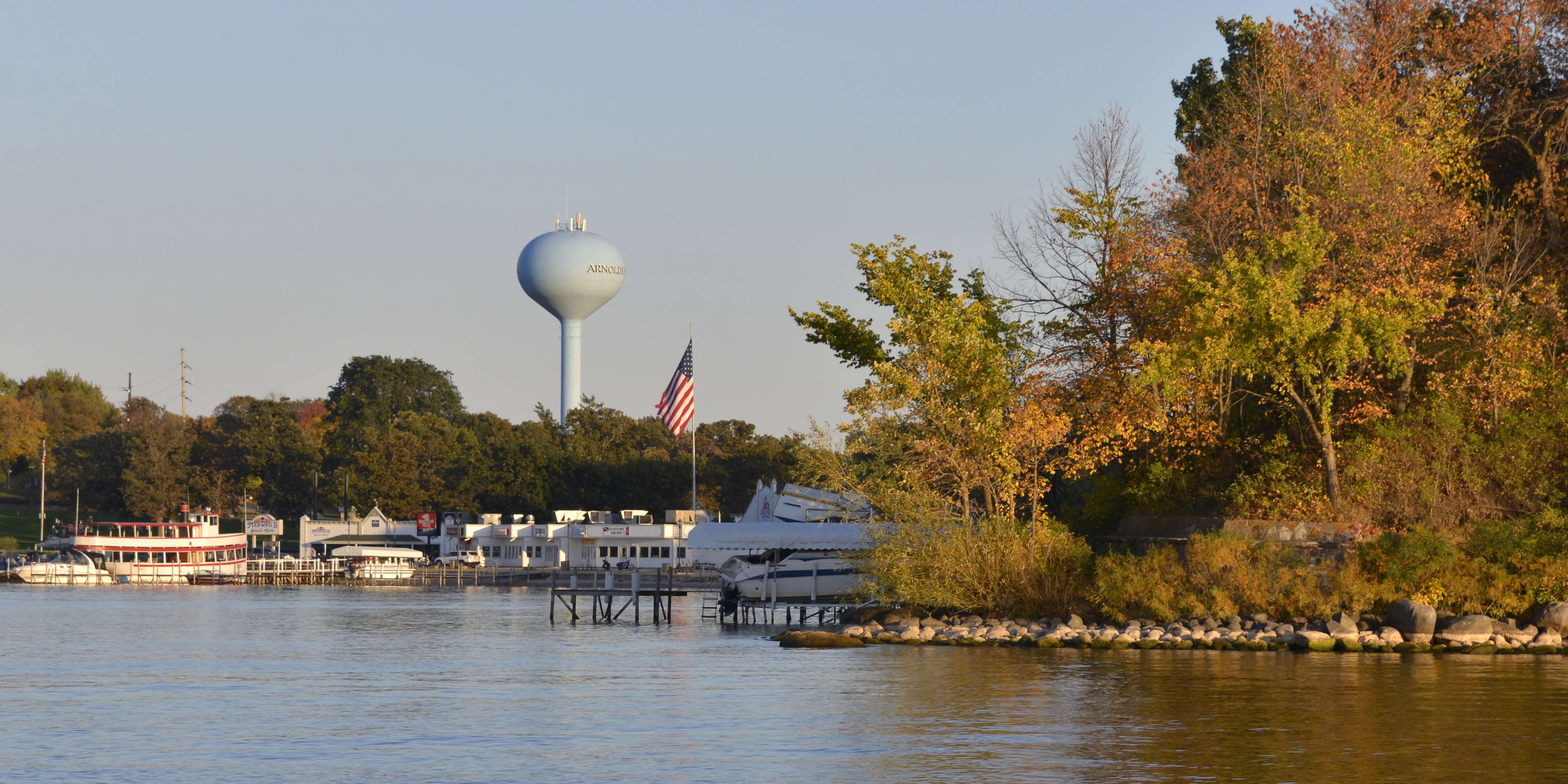 Okoboji fall landscape with park and watertower